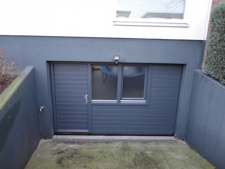 Vervangen van garagedeur voor kozijn met deur Ommelandvaart Almere