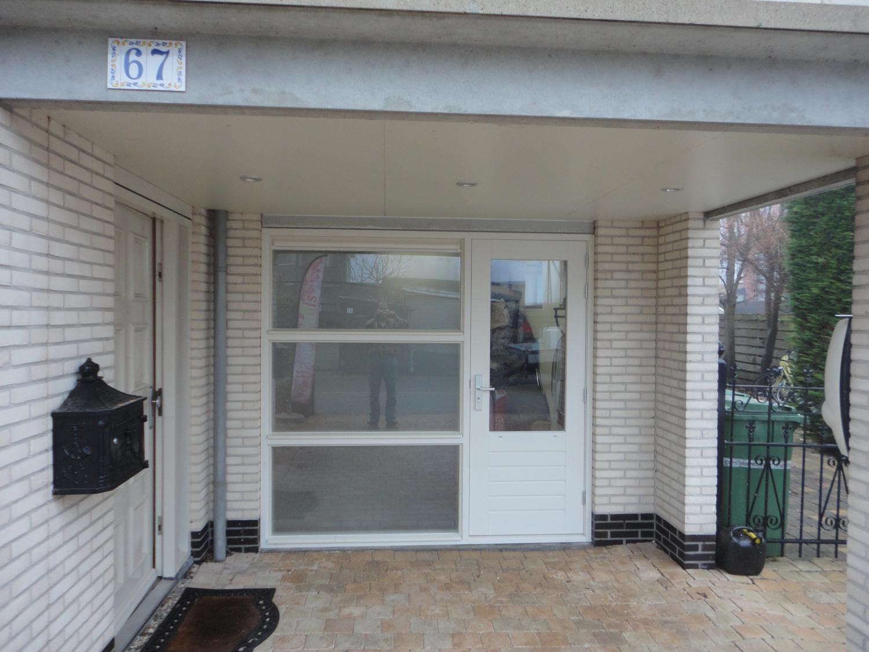 Vervangen garagedeur voor deur met 3 vast glas vakken Ommelandvaart Almere