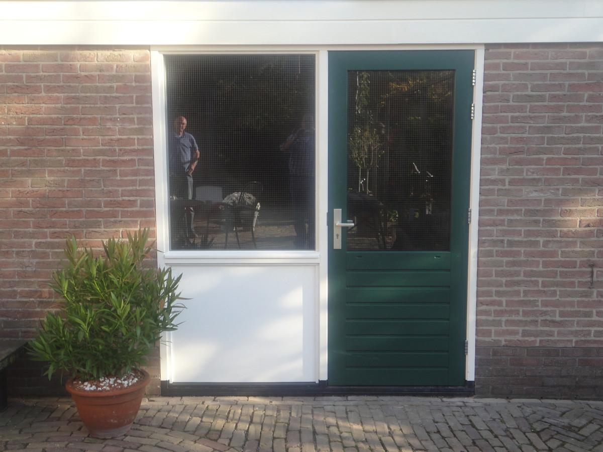 Kozijn met trespa paneel en stapeldorpeldeur Lange Haeg Ermelo
